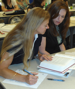 students discussing a textbook